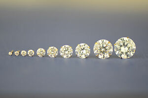 14k yellow gold round bright clear cubic zirconia prong set stud earrings