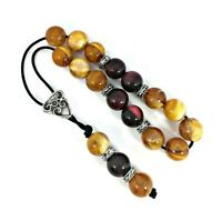 Greek komboloi with yellow and dark red marble colored beads and silver details