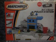 2000 matchbox  roll.n rescue  police station w 1 police car/ new