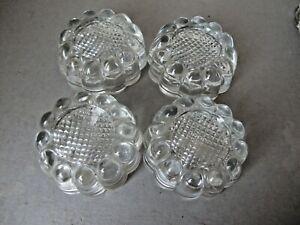 SET OF FOUR ANTIQUE CLEAR GLASS FURNITURE CASTORS