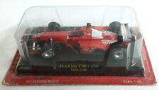 FERRARI F399 1999 Eddie IRVINE F1 FORMULE 1 N°4 rouge au 1/43 sous blister