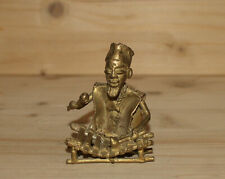 Vintage hand made bronze figurine African man play on xylophone