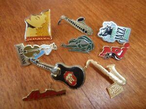 Lot de neuf  pins, thème musique, jazz, Madonna, Rolling Stones