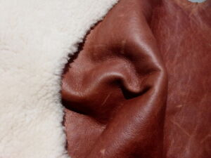 sheepskin shearling leather hide Curly Off White w/Antiqued Tobacco Bomber back