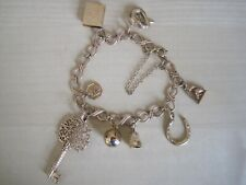 9ct Yellow Gold Charm Bracelet with 8 Charms