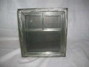 Unbranded  Pewter Frame holds 3 photos  2 ( 2x3) and 1( 3x5)