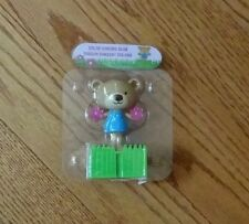 NEW IN PACKAGE -- DANCING SOLAR BROWN BEAR WITH FLOWER POM POMS