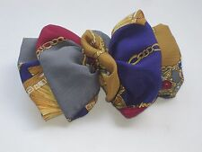 "Lovely Multi Colored With a Royal Design Hair Bow 7"" Across"