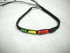BLACK CORD MACRAME WEAVE w RASTA BEADS RED GREEN YELLOW TIE BRACELET OR ANKLET