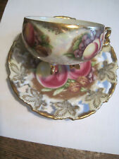 VTG ROYAL SEALY LEAF HANDLE RETICULATED IRIDESCENT 3 FOOTED ORCHARD CUP&SAUCER