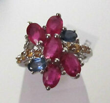 Vibrant colours in this ruby, sapphire and diamond ring, set in sterling silver