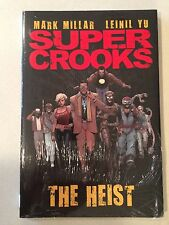 Super Crooks The Heist sealed hardcover in brand new condition