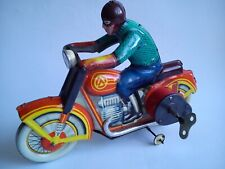 Old tin toy motorcycle wind up made in USSR