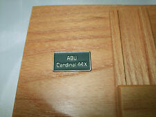ABU CARDINAL 44X SIDE PLATE BADGE