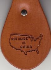 NOT MADE IN CHINA stamp. Delrin laser engraved clicker stamp