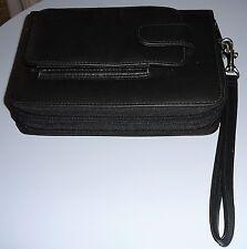 Unisex leather daytimer or travel bag, circa 1990s. Daytimer never written in.