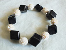 """Beautiful Stretch Bracelet Black and Off White Carved Plastic Beads 5/8"""" Wide"""