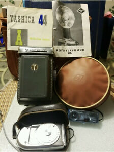 Vintage Yashica 44 Camera With Case, Camera Bag, Light Meter, Flash Bulbs, More…