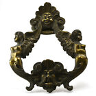 Antique massive brass door knocker with winged figures angles in an Asian motif