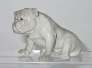 Small unmarked Seated Bulldog by Gebruder Heubach, Germany. CIRCA 1900 - 25