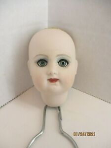 """Bisque porcelain doll head, painted face, Blue glass eyes No Wig 3"""" tall Item #1"""
