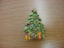 Christmas Tree Pin made of plastic to resemble wooden boards.