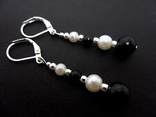 A PAIR OF DANGLY BLACK  & WHITE  GLASS PEARL LEVERBACK HOOK  EARRINGS.