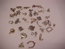 30 Sterling silver 925 charms weigh 68 .6 grams assorted from jewelry store buy