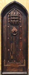 Rustic reclaimed lumber arched top Tudor DOOR speakeasy wrought iron hardware
