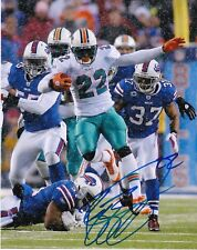 REGGIE BUSH  MIAMI DOLPHINS   ACTION SIGNED 8x10