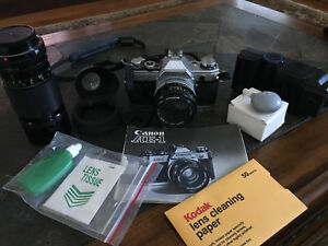 Canon AE-1 35mm SLR Film Camera with FD 50 mm lens Kit, accessories