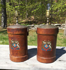 "TWO ANTIQUE BRITISH LEATHER CORDITE CARRIERS ""COAT OF ARMS"" CONVERTED TO LAMPS"
