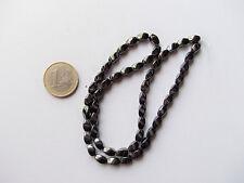 1filo/52pz  perline pietre ematite ovale ritorto 8x5mm  colore nero