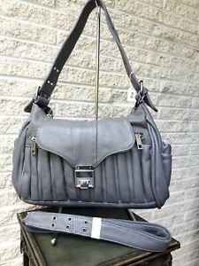 Grey leather handbag.Two straps length options. Loads of pockets.