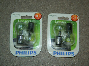 (2) NEW PACKS OF 2 PHILIPS LONGER LIFE 1034 TRUNK OR CARGO LIGHT BULBS 1034LLB2