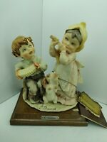 G.Armani Capodimonte Florence Statuette Porcelain boy and girl playing music - a