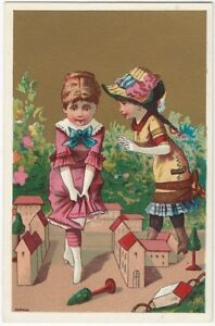 Two Girls in Bonnets with Toy Town Houses Gold & Color Victorian Trade Card