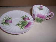 SHELLEY DEMITASSE CUP & SAUCER  PINK HANDLE & TRIM IN THISTLE PATTERN