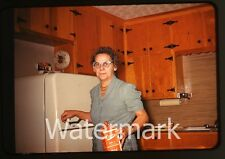 1960s Amateur  Photo slide Lady in kitchen refrigerator milk carton