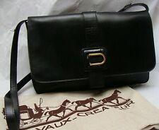 👜  sac DELVAUX, cuir noir  + son sac de protection.