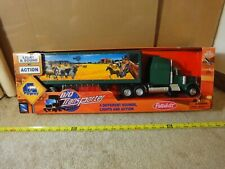 New Ray 1/32 Peterbilt battery operated Semi Truck, Tractor Trailer. New!