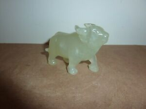 CHINESE LIGHT GREEN JADE OR SOAPSTONE 7.5 CM LONG BY 6 CM HIGH STANDING BUFFALO