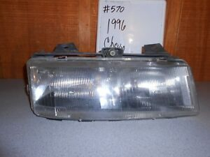 USED 1996 Chevrolet Corsica; Right Headlight with Mounting Bracket #570
