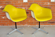 Pair EAMES / HERMAN MILLER Cushioned Naugahyde Molded Fiberglass SWIVEL CHAIRS