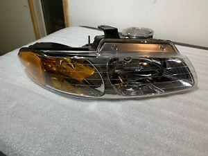 New Genuine Mopar RH Headlight fit Caravan Voyager 96-99 (V7107040AA)