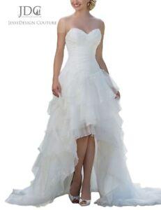 Brautkleid vorne kurz hinten lang mit Schleppe Rüschenrock Spitze Applikation
