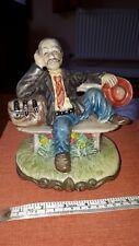 More details for retro vintage ceramic man on a bench