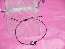 Bracelet petites menottes acier et perles sur cordon ajustable Neuf