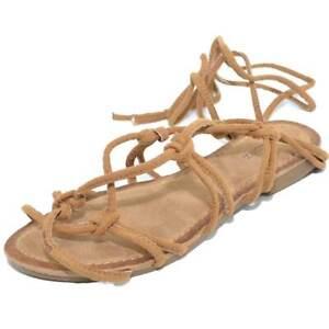 Sandali donna bassi gladiatori cuoio con allacciatura alla schiava incrociati su