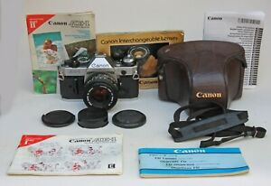 CANON AE-1 PROGRAM 35mm FILM CAMERA WITH 50mm f1.8 LENS, CASE & STRAP & PAPERS